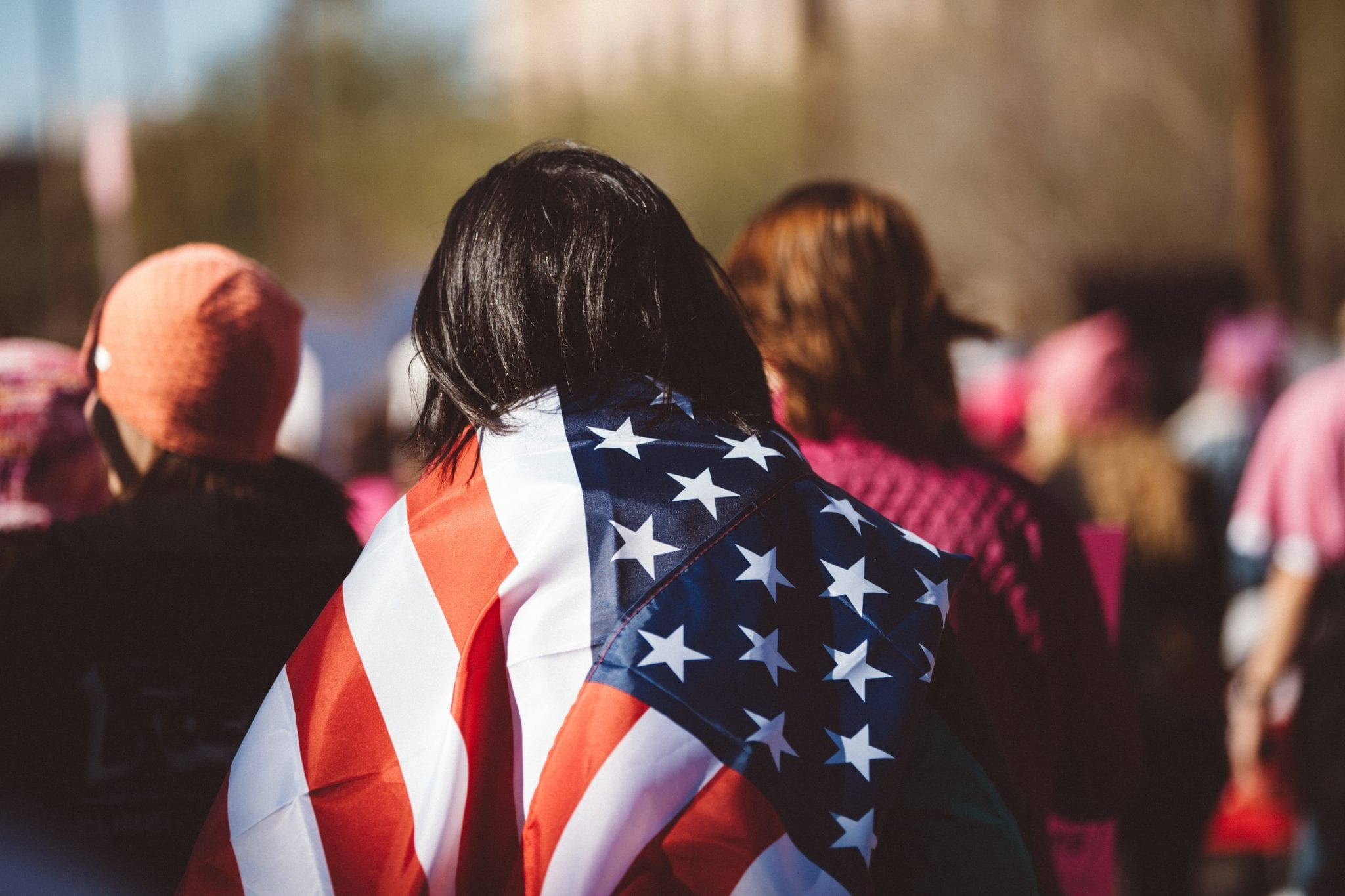 woman draped in the american flag